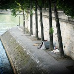 dude camping on the seine, with dog.